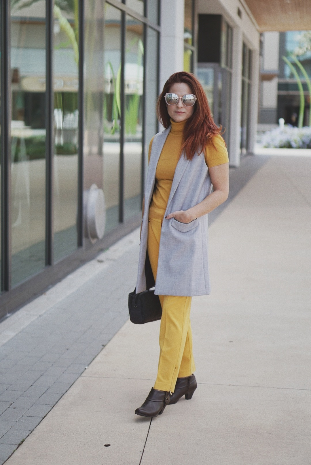 mustard yellow outfits, vest outerwear, booties,