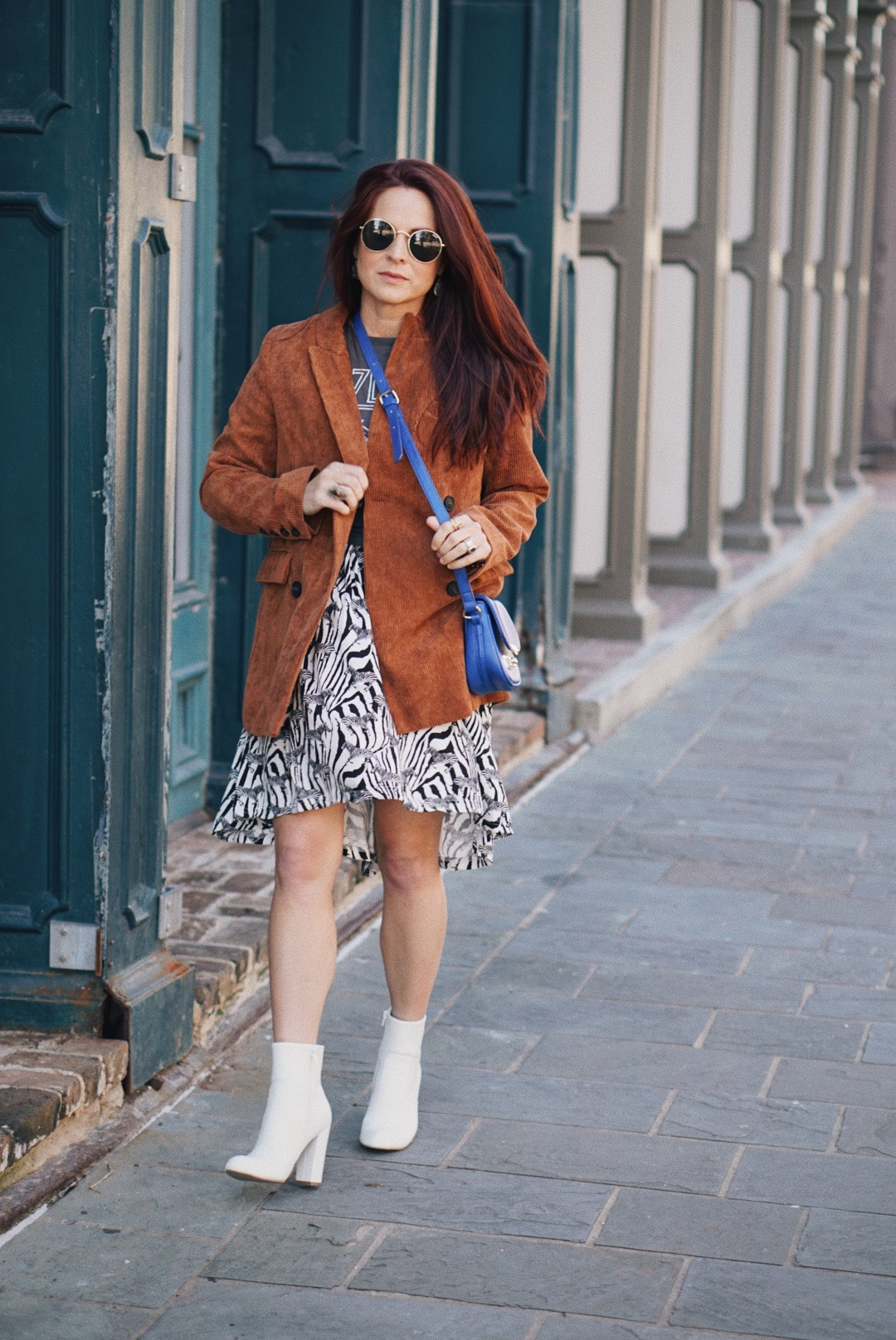 style inspiration, corduroy jackets, rust jacket, fall fashion, zebra print dress, cobalt blue bags, white boot outfits