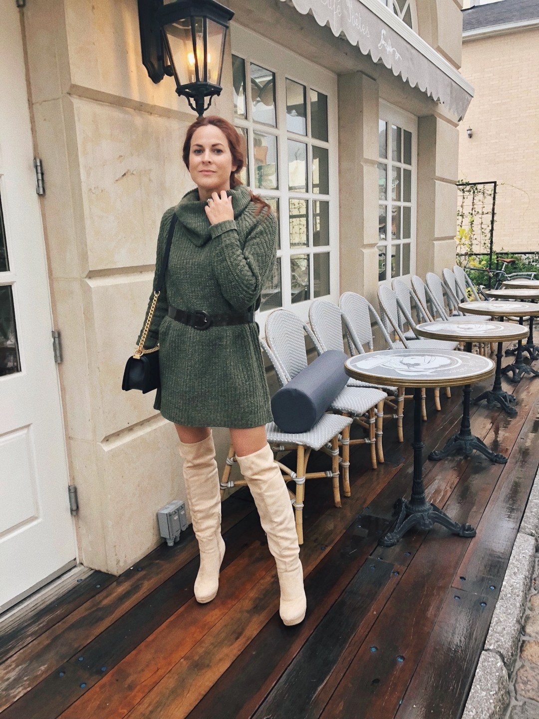 styling with a belt, sweater dresses belted, over the knee boot ideas, cream suede boots, black handbags with gold chains