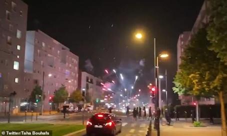 27398004-8235307-A_car_waits_at_a_cross_roads_in_the_neighbourhood_as_fireworks_e-a-1_1587361053943