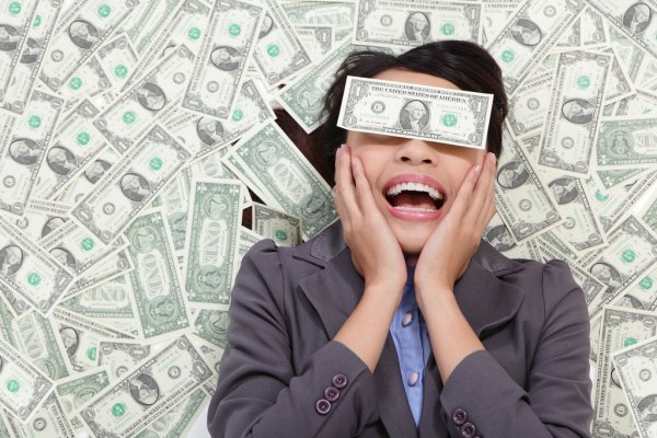 depositphotos_16980497-business-woman-excited-lying-on-money