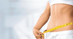 woman using measuring tape - secret to burn belly fat