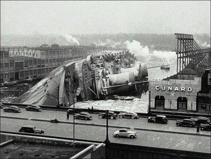 Sinking of the SS Normandie after she caught fire.
