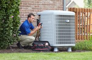 HVAC technician servicing a central AC unit