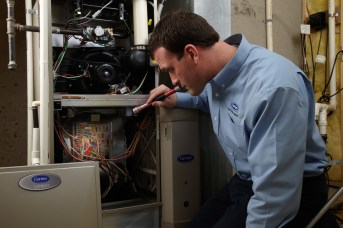 Contractor inspecting HVAC System