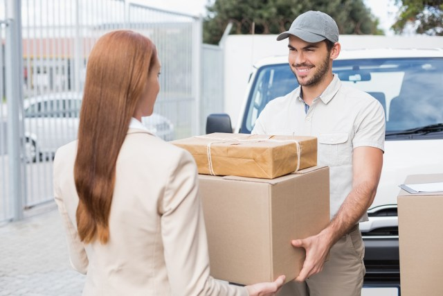 bigstock-Delivery-driver-passing-parcel-73177681.jpg
