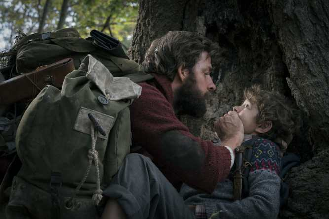 Left to right: John Krasinski plays Lee Abbott and Noah Jupe plays Marcus Abbott in A QUIET PLACE, from Paramount Pictures.