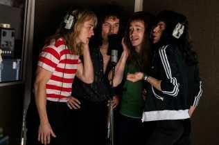 L-R: Ben Hardy (Roger Taylor), Gwilym Lee (Brian May), Joe Mazzello (John Deacon), and Rami Malek (Freddie Mercury) star in Twentieth Century Fox's BOHEMIAN RHAPSODY. Photo Credit: Alex Bailey.