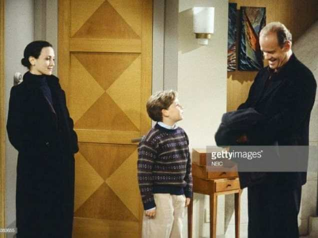"""FRASIER -- """"The Apparent Trap"""" Episodic 9 -- Pictured: (l-r) Bebe Neuwirth as Dr. Lilith Sternin, Trevor Einhorn as Frederick Gaylord Crane, Kelsey Grammer as Dr. Frasier Crane (Photo by Chris Haston/NBC/NBCU Photo Bank via Getty Images)"""