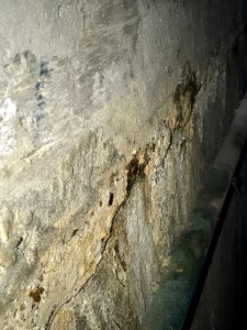 Elevator pit water damage on wall