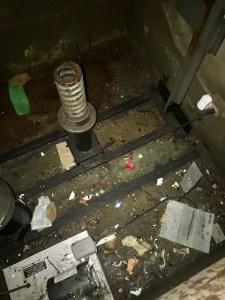 Trash accumulating in elevator pit