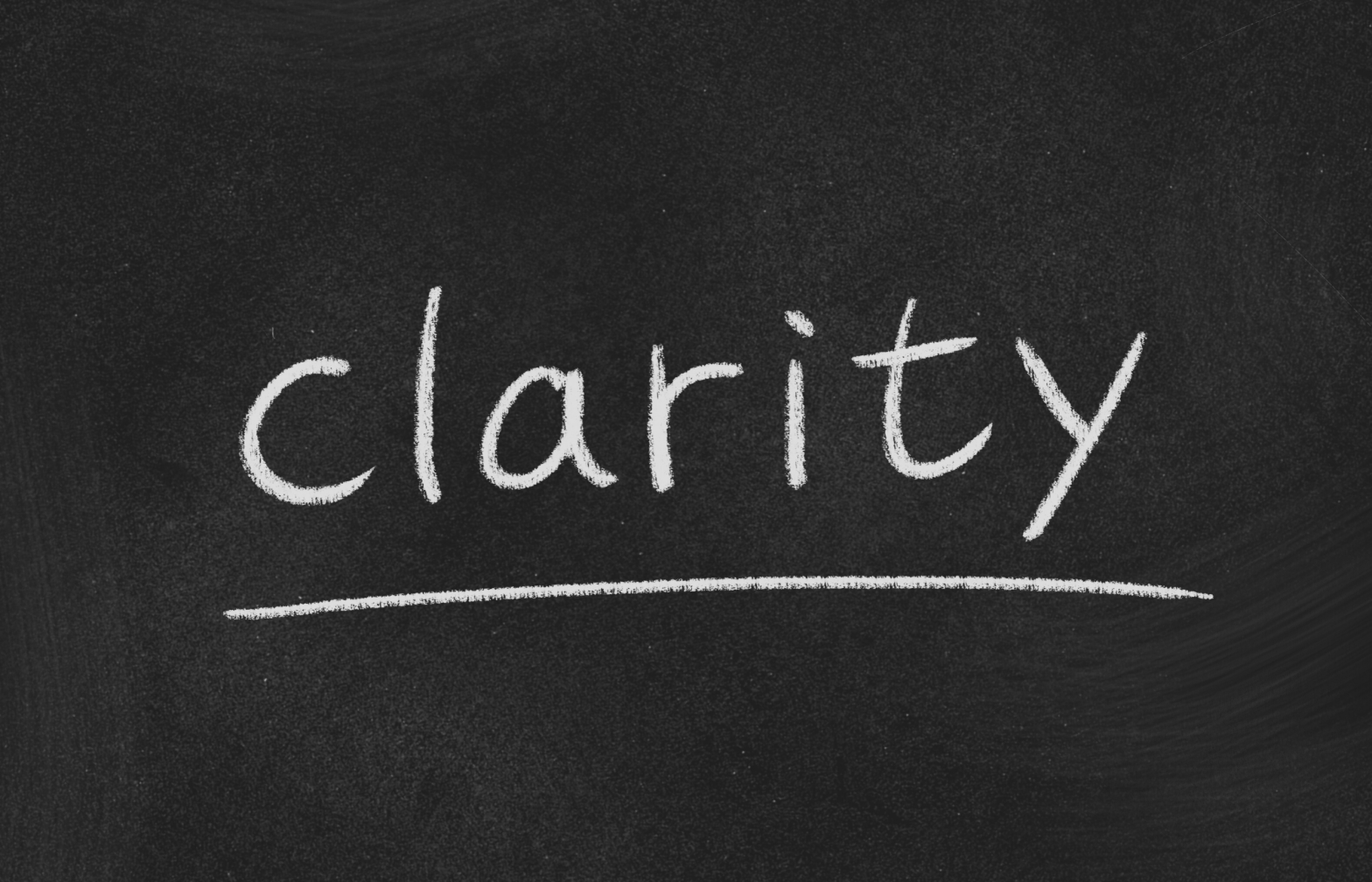 black chalkboard with the word clarity written in the center and underlined.
