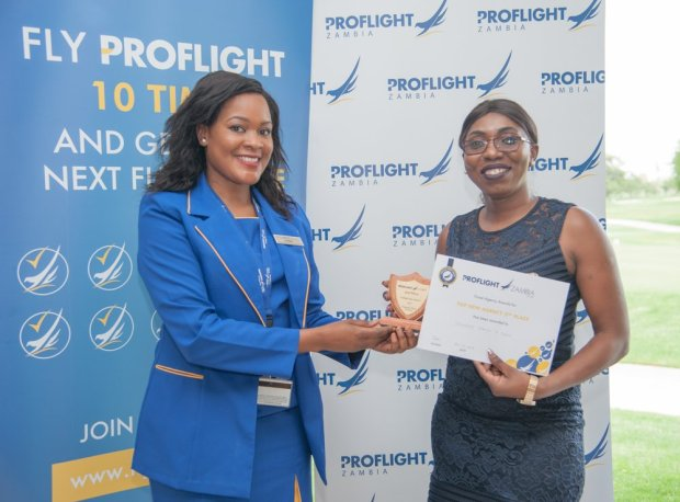 Proflight Marketing Manager Hellen Ngwira Mwamba presents the award for the 2nd Place Top New Agency to Traverze Travel and Tours
