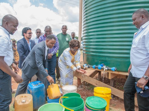 Hon. Margaret Mwanakatwe, Zambian Breweries country director Jose Moran and corporate affairs director Ezekiel Sekele test the water in Bauleni.