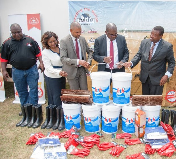 Zambeef marketing and corporate affairs manager Felix Lupindula hands over goods to Minister of Health Hon. Chitalu Chilufya, Minister of Local Government and Housing Hon. Vincent Mwale and Minister of Religious Affairs and National Guidance, Hon. Rev. Godfridah Sumaili to help with the government's fight against cholera.