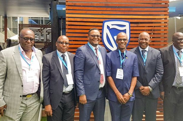 Stanbic Bank CE Mr. Leina Gabaraane (second right), hosting   Zambian Government Officials and key Stakeholder at the Standard Bank Pavilion during the Investing in African Mining Indaba in Cape Town.