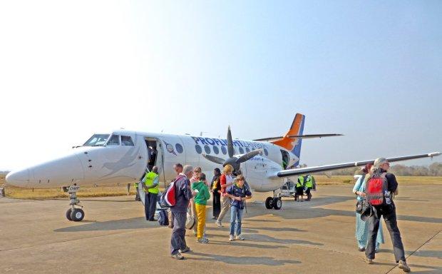 Tourists disembark from a Proflight flight