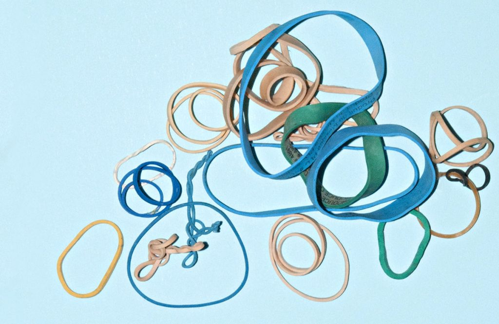 Blue and brown rubber bands on a light blue background