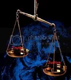 justice_scale_yellow-149x141.jpg