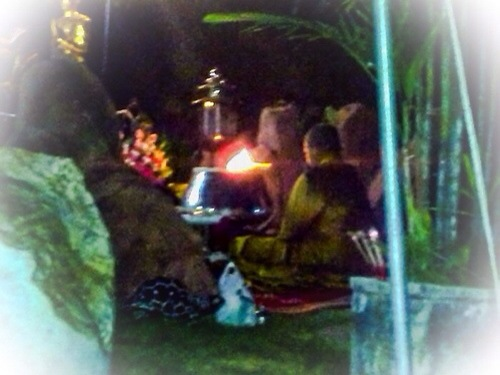Kroo Ba Krissana Intawano performing the blessing of amulets in a sacred Cave.