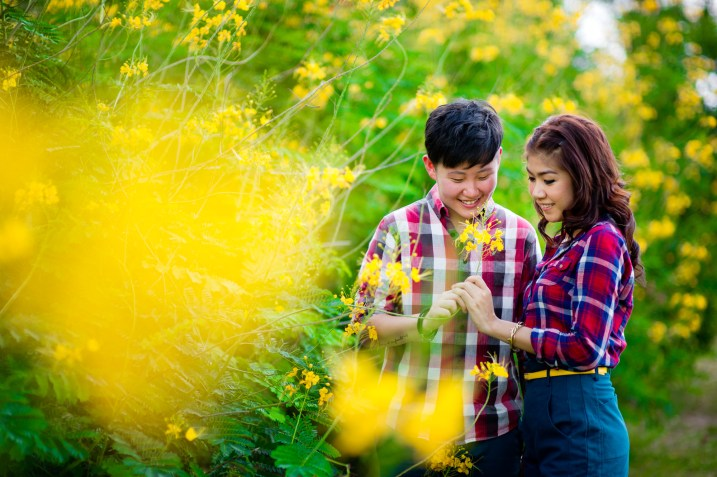 Pre-Wedding photo shoot of a lesbian couple at a park in Bangkok, Thailand.