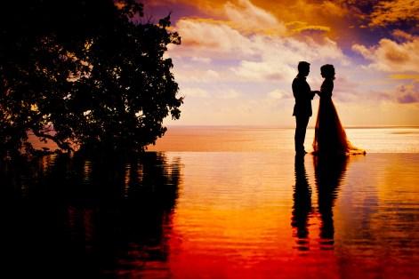Phuket, Thailand - Engagement photo taken against sunset background.