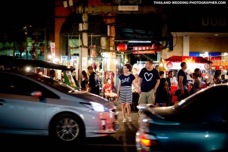 Pre-Wedding (Engagement Session, Prenuptial) photo shoot at China Town (Yaowarat Road) at night in Bangkok, Thailand.