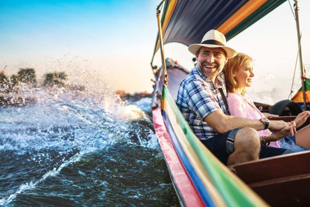 Couple take a boat tour on the Chao Phraya River. Thailand Event Guide