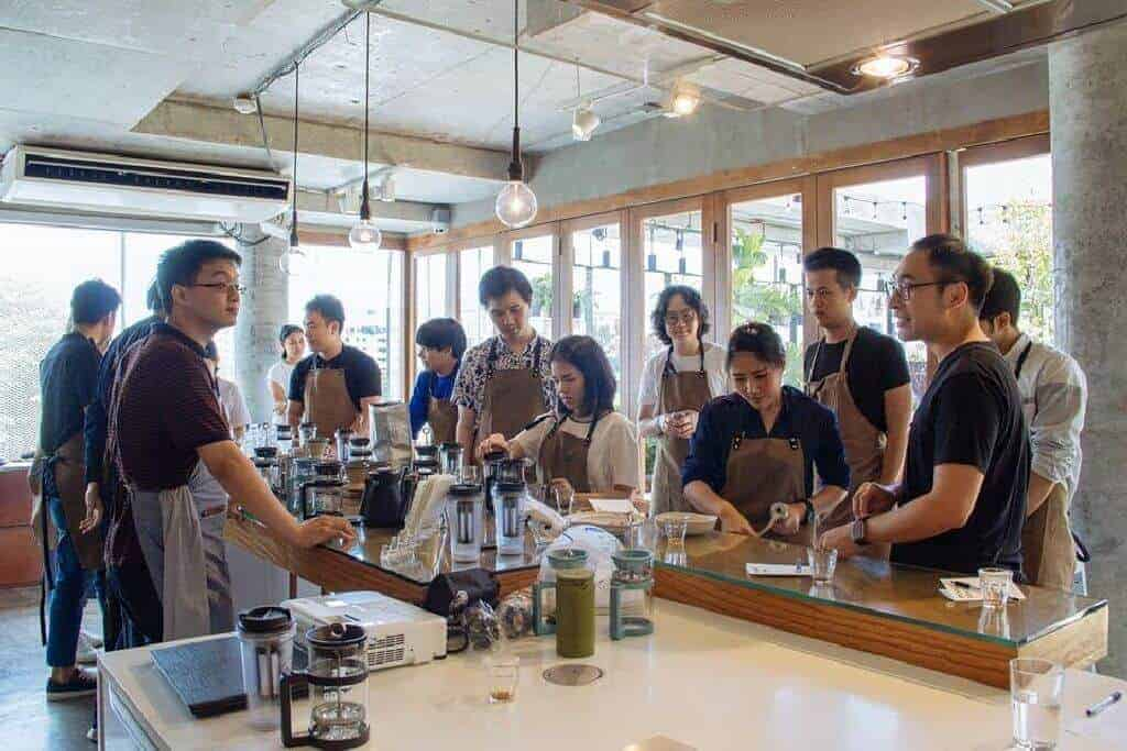 Students learn how to make coffee during a coffee workshop at thecommons. Thailand Event Guide