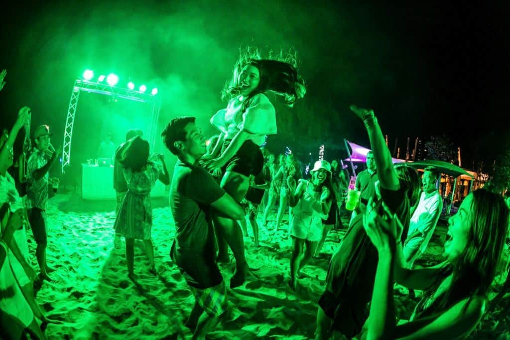 People dance on the beach in Thailand at So Beach Party Hua Hin.