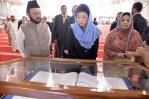 Faisal Mosque Yingluck looking at sacred writing