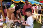 Yingluck with a young visitor