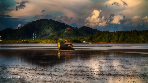 old trawler on the mud low tide sunset 16x9