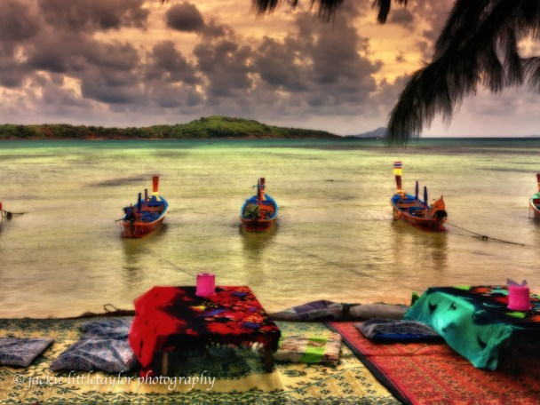 sunset Rawai beach long tail boats eating tables