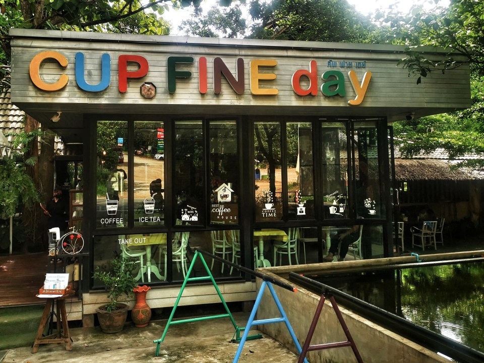 Cup fine day restaurant with playground.