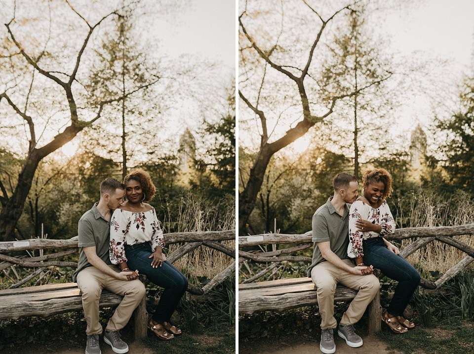 Woman sitting on man's lap on wooden bench