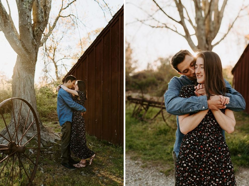 Couple holding each other outside in worn down forrest