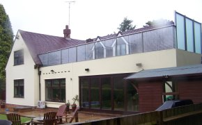 Large royal chrome balustrade with high frosted glass privacy screens