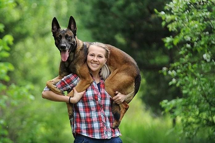 Girl and Belgian dog