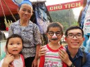 In Cao Bang province, travelling with Mr. Old Stingy Miser. The Nung lady and her grandchildren were so loving and peaceful.