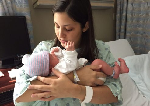 Holding Oliver for the first time before leaving the hospital