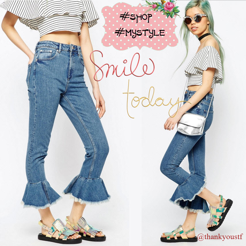 flared style jeans, top in stripe, round sunglasses, metallic saddle bag, silver sandals