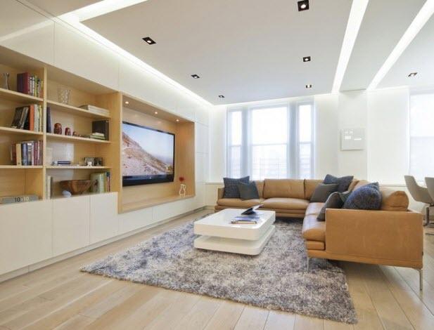 living cald cu un sistem de iluminare ascuns in tavan