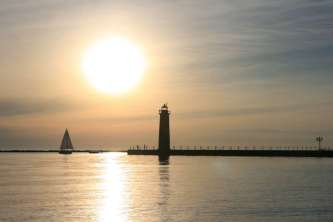 Lighthouse sail boat