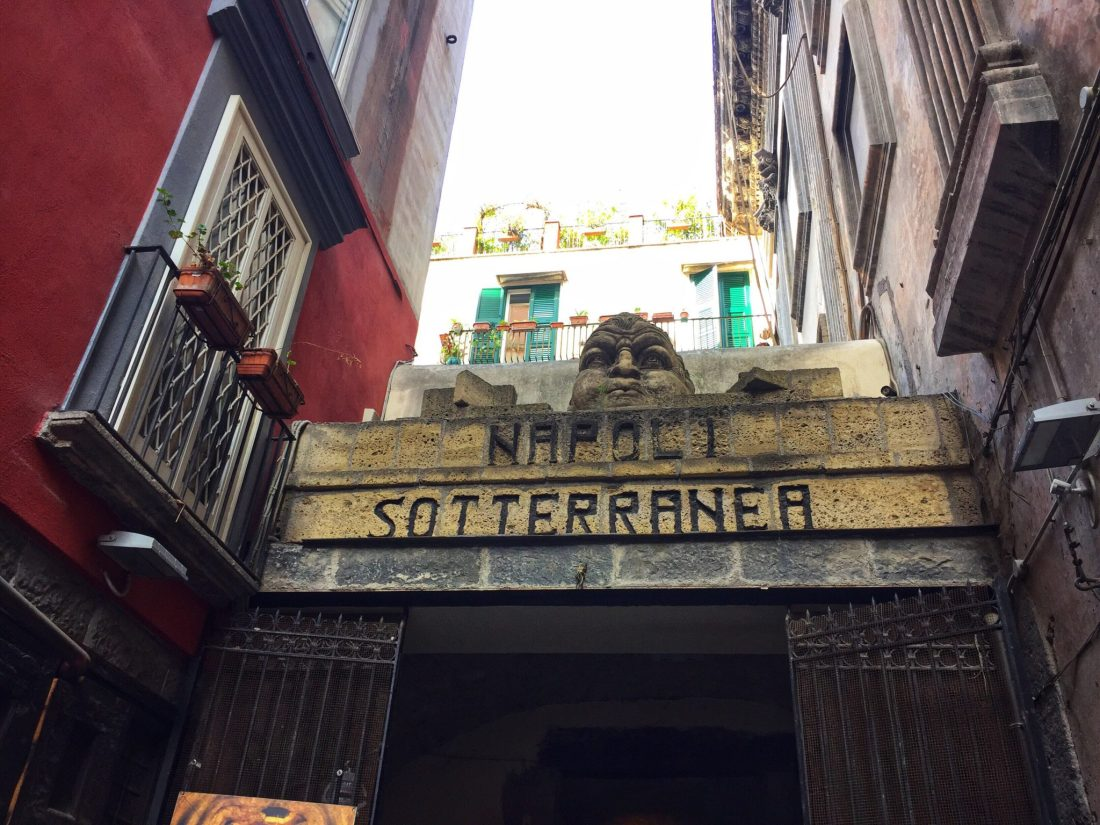Entrance of Naples Underground tour, with statue on top
