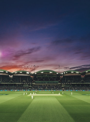 A match of cricket being played at dusk - 23 Things You Should Know Before Visiting The UK