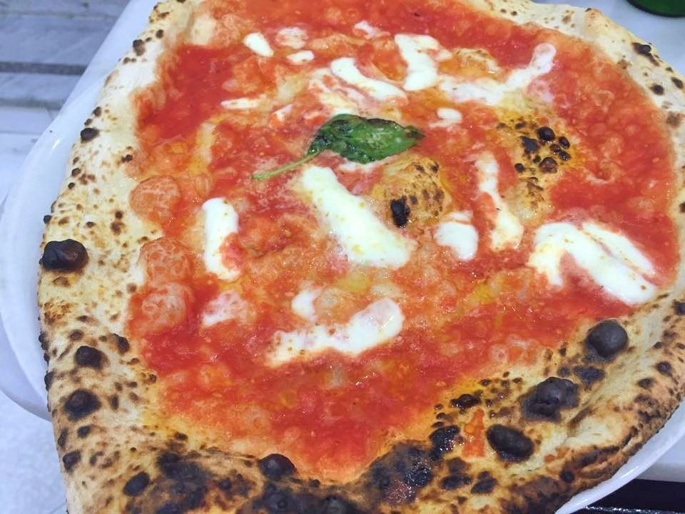 Close up view of a margarita pizza in Italy