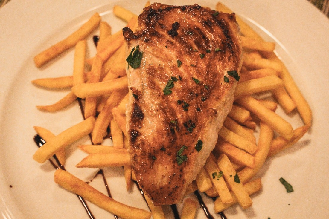 Stuffed chicken breast and french fries in Prague