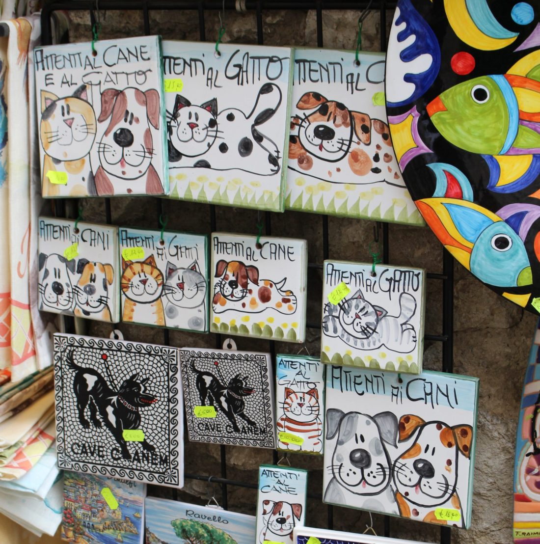 Shop selling ceramic tiles with pictures of dogs and cats on them