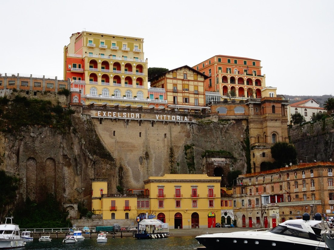 A grand hotel built on the edge of a cliff